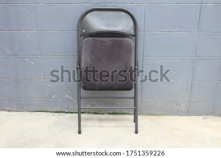 The chair is folded up. Photographed from the front. Stockfoto ©