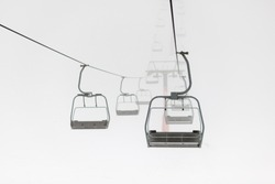 the chair lift in thick fog