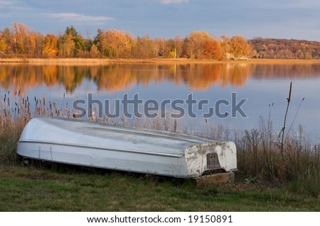 The change of seasons.  The boat is out of the water and the leaves are changing