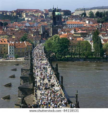 The Charles Bridge over the Vltava river,built in baroque style, in Prague is always crowded with tourists, artists and musicians. The other side of the bridge is called Mala Strana.