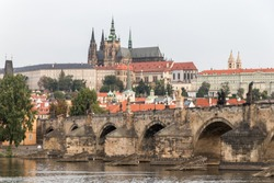 The Charles Bridge spans the river under the eye of Prague Castle