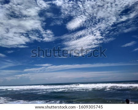 the charm of the beauty of the beach with the blue sky and charming waves