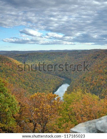 The Cheat River flows the the Cheat River gorge as seen from the Cooper's Rock State forest overlook in autumn. The park and gorge are located just east of Morgantown, West Virginia.