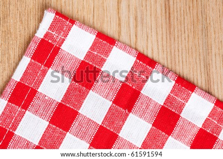 the checkered tablecloth on wooden table
