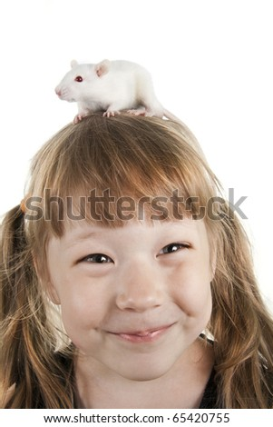 The cheerful girl with a rat on her head