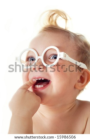 The cheerful little girl in glasses