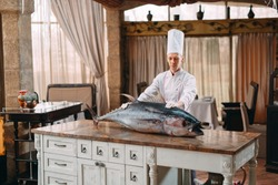 The chef cut up a big Tuna fish in the restaurant