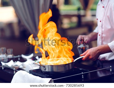 The chef prepares the Foie gras before the guests. Stock photo ©