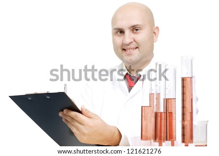 the chemist of young age in goggles and a dressing gown with flasks in hands on a white background