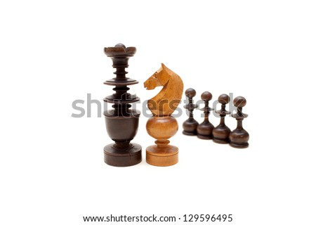 The chess pieces on the white