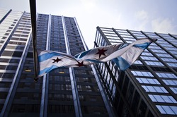 The Chicago flag hangs from a downtown building.