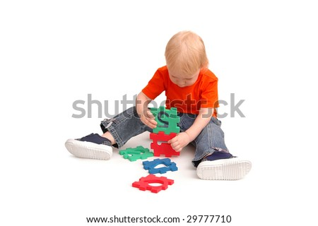 The child collects puzzles