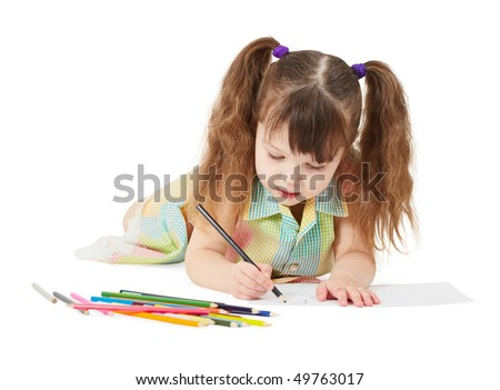 The child draws a crayon drawing on white