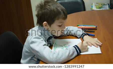 the child draws a picture