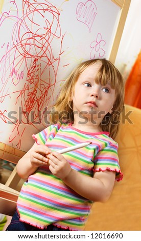 The child draws on the board 2