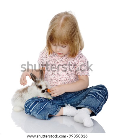 The child feeds easter rabbit. isolated on white background
