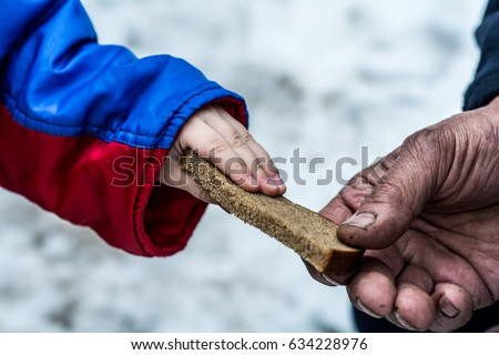 Shutterstock The child gives the man a piece of rye bread.