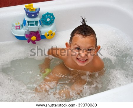 The child in bathing filled with water with foam