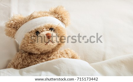 The child is hurt.Teddy bear with bandage in the hospital, space for text #715173442