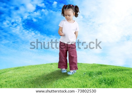 The child playing in the field