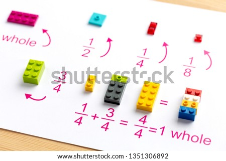 The child puts the colored blocks in the right place. Math games for children. Mathematics, logic, training Stock fotó ©