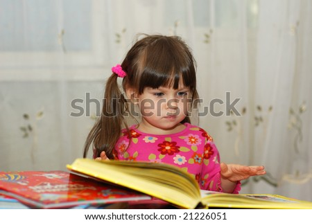 The child reading the book
