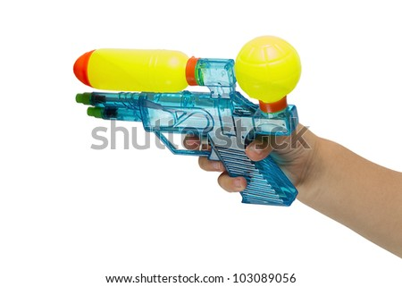 The child's hand with a water pistol isolated on white background