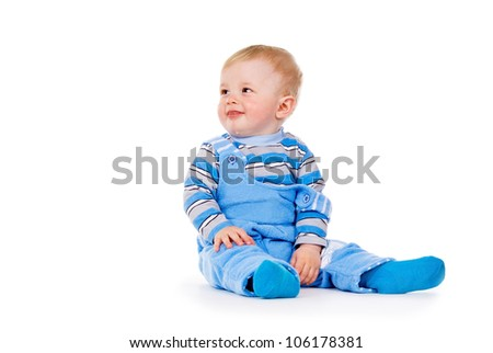 the child sits isolated on white background
