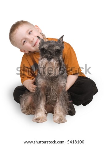 The child sits with a dog on a white background