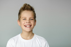 The child smiles and shows jagged teeth. Dental medicine and healthcare