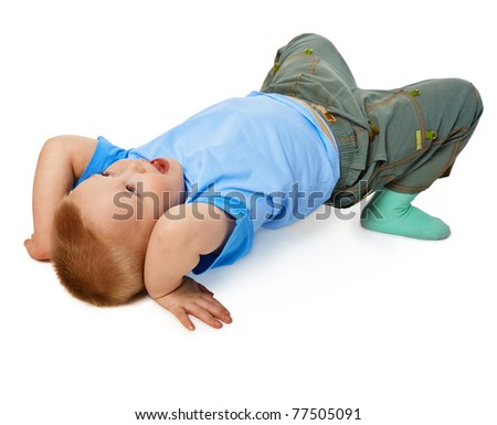 The child tries to do a gymnastic stance on the floor isolated on white background