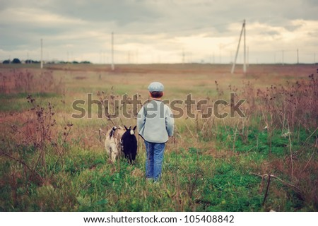 the child with a kid in the field - stock photo