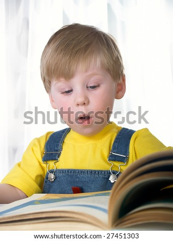 The child with books on the white background