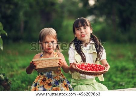 The Children eating cherries in the garden.