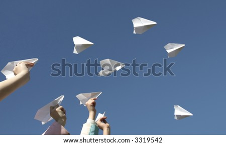 The Children throw skyward airplanes from paper.