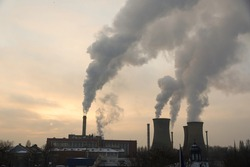 The chimney of a thermal power plant, the smoke extracted by a thermal power plant on the chimney, in the production process. Environment. Pollution.