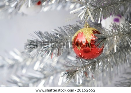 The christmas ornament with the christmas tree.