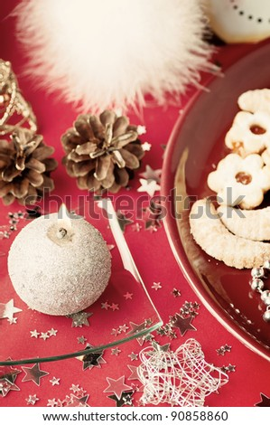 The christmas still life on a red background .