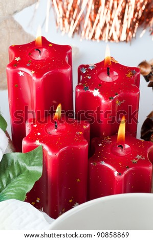 The christmas still life - red candles and flower .