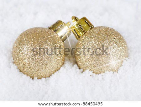 The christmas tree ball in snow background