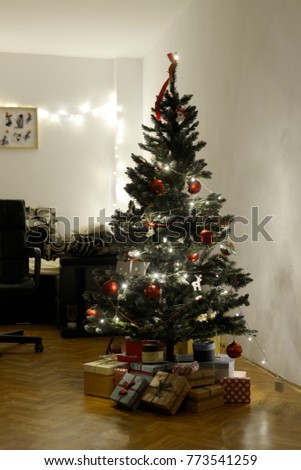The Christmas tree in the room #773541259
