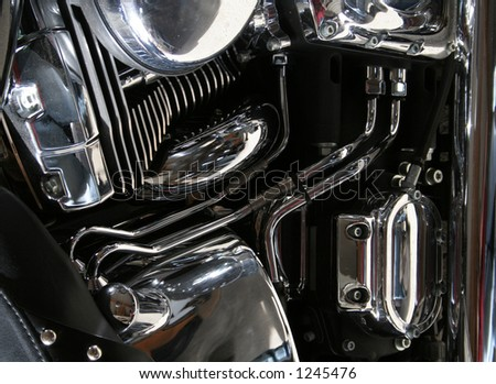 The chrome engine of a motorcycle.