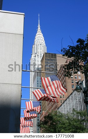 The Chrysler Building and flags along 42nd street in Midtown Manhattan.