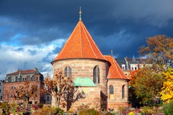 the church in the Nuremberg cemetery , Church St. Johannis in Nuremberg Germany , graveyard in the autumn
