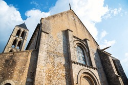 The Church of Our Lady of the Assumption in medieval city of Chateau-Landon in Seine-et-Marne department of Ile-de-France region, France. This building mixes Carolingian, Romanesque and Gothic styles.