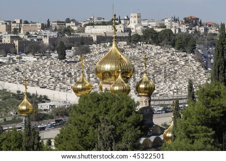 The Church of Saint Mary Magdalene.  This is a Russian Orthodox Church as seen from the Mount of Olives in Jerusalem, Israel.  Known for its golden cupolas it was build by Alexander III of Russia