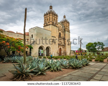 The Church of Santo Domingo pictured under cloudy skies in Oaxaca, Mexico