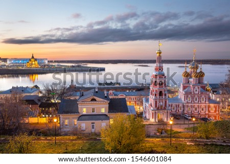 The Church of the Cathedral of the Blessed Virgin in Nizhny Novgorod against the backdrop of a beautiful sunset in the fall and Alexander Nevsky Cathedral in the background Сток-фото ©
