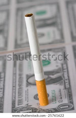 the cigarette on american money - stock photo