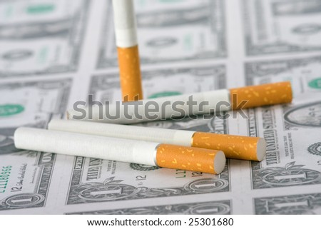 the cigarettes laying on american money